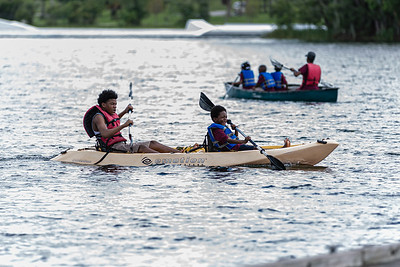Two boys paddle a kayak in the lake at Okeeheelee Park in West Palm Beach, Friday, July 17, 2020. [JOSEPH FORZANO/palmbeachpost.com]