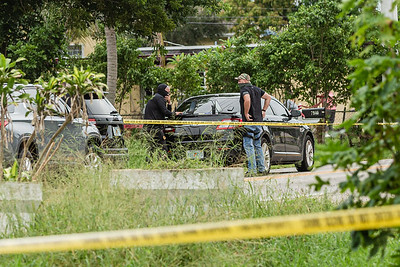 Palm Beach County Sheriff's Officers stand outside a home where two women died of gunshot wounds in the 7900 block of Overlook Road the San Castle neighborhood of Lake Worth. [JOSEPH FORZANO/palmbeachpost.com]