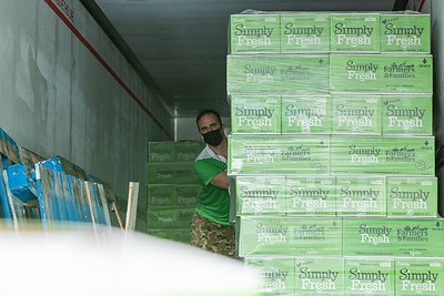 Steve McKracken, the Sergeant at Arms of the West Palm Beach Chapter of the American Culinary Federation and Head Chef at Edgwater at Boca Pointe, pushes a palette of boxed produce to the end of the 53' semi trailer for distribution in the parking lot of the Home Depot on Northlake Blvd. in Lake Park, Friday, July 24, 2020. In conjunction with Home Depot, the ACF has been distributing food for free at this location for the past three Fridays and will back for the next three Fridays. Over 1,440 boxes of produce will be distributed today. The boxes contain various items of fresh produce including lettuce, plums and other fruits and vegetables. [JOSEPH FORZANO/palmbeachpost.com]