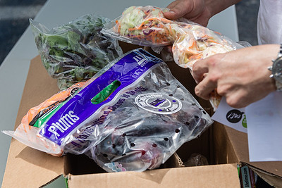A closer look at one of the boxes of produce being distributed for free in the parking lot of the Home Depot on Northlake Blvd. in Lake Park, Friday, July 24, 2020. In conjunction with Home Depot, the West Palm Beach Chapter of the American Culinary Federation has been distributing food at this location for the past three Fridays and will back for the next three Fridays. Over 1,440 boxes of produce will be distributed today. The boxes contain various items of fresh produce including lettuce, plums and other fruits and vegetables. [JOSEPH FORZANO/palmbeachpost.com]