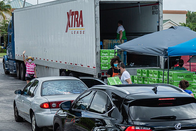 Cars are lined up to receive free boxes of produce in the Home Depot parking lot on Northlake Blvd., in Lake Park, Friday, July 24, 2020. Members of the West Palm Beach Chapter of the American Culinary Federation and Home Depot distributed free boxes of produce to anyone who drove up to the Lake Park location. In conjunction with Home Depot, the ACF has been distributing food for free at this location for the past three Fridays and will back for the next three Fridays. Over 1,440 boxes of produce will be distributed today. The boxes contain various items of fresh produce including lettuce, plums and other fruits and vegetables. [JOSEPH FORZANO/palmbeachpost.com]