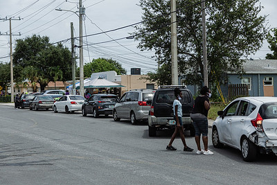 Cars line up outside the Above the Sea Restaurant on Wingfield Street in Lake Worth Beach, Tuesday, July 28, 2020. The restaurant, owned by Patrick Livingston, has been providing food and hot meals to community members since 2011. [JOSEPH FORZANO/palmbeachpost.com]