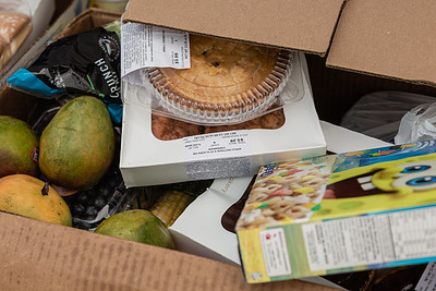 A box full of some of the food stuffs being given away at the Above the Sea Restaurant on Wingfield Street in Lake Worth Beach, Tuesday, July 28, 2020. The restaurant, owned by Patrick Livingston, has been providing food and hot meals to community members since 2011. [JOSEPH FORZANO/palmbeachpost.com]