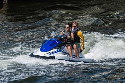A couple ride a watercraft out of the Boynton Inlet in Boynton Beach, Friday, July 31, 2020. [JOSEPH FORZANO/palmbeachpost.com]