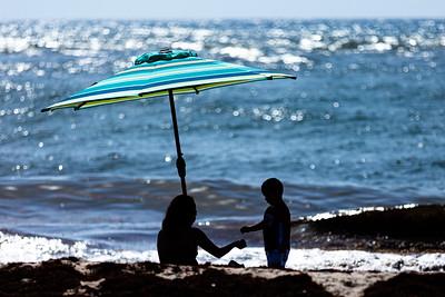 A mother and her son play on the beach at Boynton Inlet in Boynton Beach, Friday, July 31, 2020. [JOSEPH FORZANO/palmbeachpost.com]