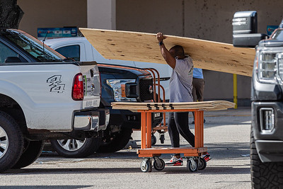 A man loads plywood into the bed of his pickup truck at the Home Depot on Palm Beach Lakes Blvd. in West Palm Beach, Friday, July 31, 2020, in preparation for Hurricane Isaias. [JOSEPH FORZANO/palmbeachpost.com]