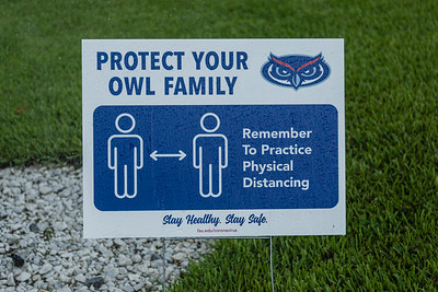 A FAU branded sign reminding people to keep socially distant while on the Florida Atlantic University campus in Boca Raton, Tuesday, August 11, 2020. [JOSEPH FORZANO/palmbeachpost.com]