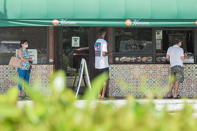 Patrons at Havana Cafe in West Palm Beach remain socially distant while lined up at the take out window, Friday, August 14, 2020. [JOSEPH FORZANO/palmbeachpost.com]