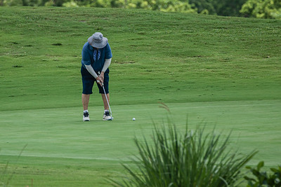 A golfer putts on the 6th hole of the Heron course at Okeeheelee Golf Course in West Palm Beach on Friday, August 14, 2020. [JOSEPH FORZANO/palmbeachpost.com]