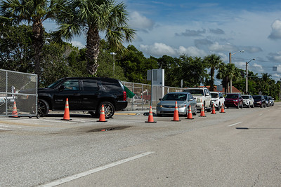 Cars queue up on Parker Avenue as students and parents wait to get into Forest Hill Community High School in West Palm Beach,where computer equipment was being distributed for 10th graders of the high school, Monday, August 17, 2020. [JOSEPH FORZANO/palmbeachpost.com]