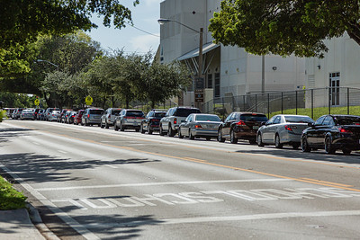 A long line of cars stretches down Forest Hill Blvd., as students and parents wait to get into Forest Hill Community High School in West Palm Beach, where computer equipment was being distributed for 10th graders of the high school, Monday, August 17, 2020. [JOSEPH FORZANO/palmbeachpost.com]