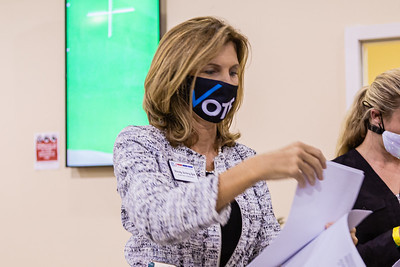 Palm Beach County Supervisor of Elections, Wendy Sartory Link, hands out hard copies of the first returns at the tabulation center in Riviera Beach on Tuesday, August 18, 2020. Link, who was appointed by Governor Ron DeSantis is running in the primary for the Supervisor of Elections for Palm Beach County as a Democrat against Democrat Paulette Armstead. [JOSEPH FORZANO/palmbeachpost.com]