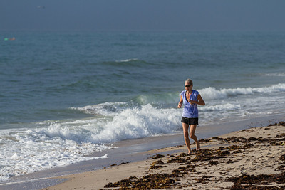 A woman jogs on Delray Public Beach off South Ocean Blvd., Thursday, August 20, 2020. [JOSEPH FORZANO/palmbeachpost.com]