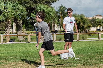 Garrett Mine of Jupiter (left) practices his lacrosse skills under the watchful eye Reef Kabalin, also of Jupiter, at Jupiter Lighthouse Park, Monday, August 24, 2020. Mine is honing his skills so he can try out for the Jupiter High School lacrosse team in the upcoming school year. [JOSEPH FORZANO/palmbeachpost.com]