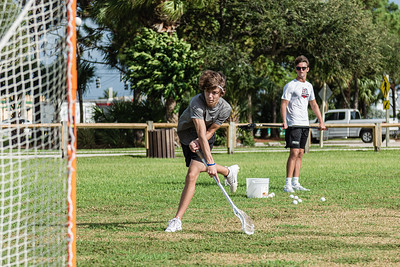 Garrett Mine of Jupiter (left) fire a shot at the goal while practicing his lacrosse skills under the watchful eye Reef Kabalin, also of Jupiter, at Jupiter Lighthouse Park, Monday, August 24, 2020. Mine is honing his skills so he can try out for the Jupiter High School lacrosse team in the upcoming school year. [JOSEPH FORZANO/palmbeachpost.com]