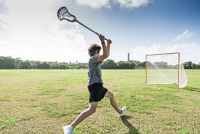Garrett Mine of Jupiter readies a shot on the goal while practicing at Jupiter Inlet Lighthouse, Monday, August 24, 2020. Mine is honing his skills so he can try out for the Jupiter High School lacrosse team in the upcoming school year. [JOSEPH FORZANO/palmbeachpost.com]