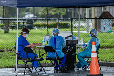 Medical Assistants Lulu Scarpa, left, Elsa Escribino and nurse practitioner Guerlyne Estine prepare COVID testing materials at a coronavirus testing site in the parking lot of the Greenacres Community Center, Wednesday, August 26, 2020. No appointments are necessary at the testing site. [JOSEPH FORZANO/palmbeachpost.com]
