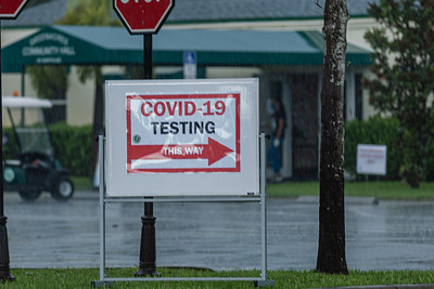 A sign directs people where to go for COVID-19 testing at the Greenacres Community Center, Wednesday, August 26, 2020. No appointments are necessary at the testing site. [JOSEPH FORZANO/palmbeachpost.com]