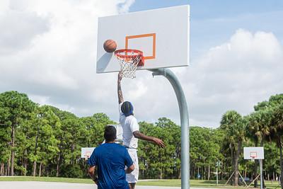 Sheinord Philizaire of Boynton Beach, makes a layup against Edwin Granadeno, also of Boynton Beach, during a game of basketball on one of the courts at Caloosa Park in Boynton Beach, Friday 28, 2020. [JOSEPH FORZANO/palmbeachpost.com]