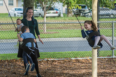 Robyn Wolf of Boca Raton watches as her children, Aryeh, left, and Devorah play on the swings at Sandalfoot Cove Park in Boca Raton, Friday, August 28, 2020. Playgrounds reopened in Palm Beach County for the first time since the onset of the coronavirus pandemic. [JOSEPH FORZANO/palmbeachpost.com]