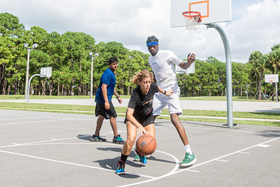 Ali Lewis of Boynton Beach dribbles the ball, while being defended by Sheinord Philizaire as Edwin Granadeno, also of Boynton Beach looks on, on one of the courts at Caloosa Park in Boynton Beach, Friday 28, 2020. [JOSEPH FORZANO/palmbeachpost.com]