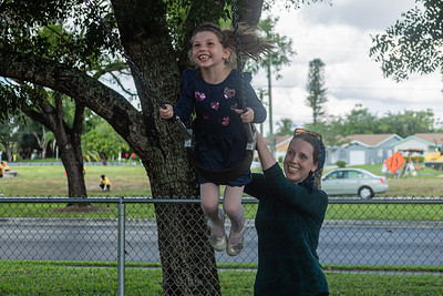 Robyn Wolf of Boca Raton pushes her daughter Devorah, 5, on the swings at Sandalfoot Cove Park in Boca Raton, Friday, August 28, 2020. Playgrounds reopened in Palm Beach County for the first time since the onset of the coronavirus pandemic. [JOSEPH FORZANO/palmbeachpost.com]