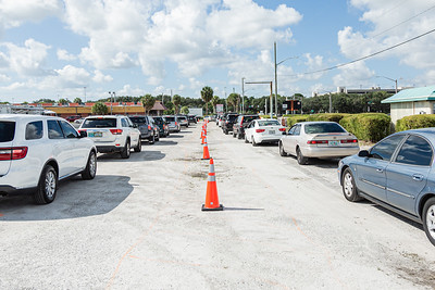 Cars are lined up at the lot across the street from the Palm Beach Kennel Club in West Palm Beach, where Back to School PBC! and other agencies were holding a by invitation only school supply giveaway, Saturday, August 29, 2020. Over 4,500 people were expected at the event at the Kennel Club. Back to School PBC! Has partnered with several agencies and has 6 sites throughout Palm Beach County which will supply roughly 10,000 students with school supplies and food. [JOSEPH FORZANO/palmbeachpost.com]