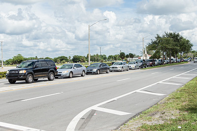 Cars are lined up on the south side of Congress Avenue waiting to turn into the lot across from the Palm Beach Kennel Club in West Palm Beach where Back to School PBC! Is holding a school supply event, Saturday, August 29, 2020. Back to School PBC! has partnered with several agencies and has 6 sites throughout Palm Beach County which will supply roughly 10,000 students with school supplies and food. [JOSEPH FORZANO/palmbeachpost.com]