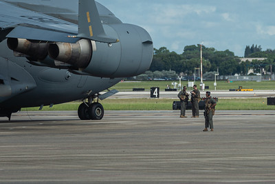 Armed members of the military guard the C-17 Globemaster as it sits on the tarmac at Palm Beach International Airport, Wednesday, September 9, 2020. [JOSEPH FORZANO/palmbeachpost.com]