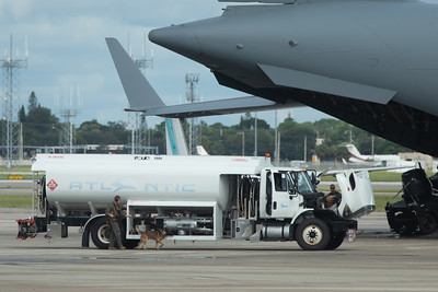 A K9 unit seaches an Atlantic Aviation fuel truck before being allowed to fuel the C-17 Globemaster at Palm Beach International Airport, Wednesday, September 9, 2020. [JOSEPH FORZANO/palmbeachpost.com]
