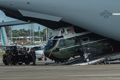 The Sikorsky VH-3D Sea King helicopter (Marine One when the President is aboard), is pulled aboard the C-17 Globemaster by an internal tow cable, as crews watch over the operation at Palm Beach International Airport, Wednesday, September 9, 2020. [JOSEPH FORZANO/palmbeachpost.com]