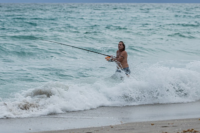 A man gets hit with a wave while surf fishing on Juno Beach, Friday, September 11, 2020. [JOSEPH FORZANO/palmbeachpost.com]