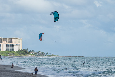 Kite surfers take advantage of a strong easterly wind to sail over the waters off of Juno Beach, Friday, September 11, 2020. [JOSEPH FORZANO/palmbeachpost.com]