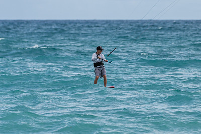 A kite surfer glides over the water on a hydrofoil board, off the shore of Juno Beach thanks to a strong easterly wind, Friday, September 11, 2020. [JOSEPH FORZANO/palmbeachpost.com]
