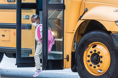 A student gets off the bus Lincoln Elementary School in Riviera Beach, Monday, September 21, 2020. Today was the first day of in person schooling since the outbreak of the COVID-19 pandemic. [JOSEPH FORZANO/palmbeachpost.com]