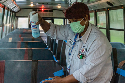 Palm Beach County School bus driver Nadine Cousins sanitizes the seats of her school bus after dropping off students at Lincoln Elementary School in Riviera Beach, Monday, September 21, 2020.  Bus drivers were required to sanitize their busses after dropping students off at school. Today was the first day of in person schooling since the outbreak of the COVID-19 pandemic. [JOSEPH FORZANO/palmbeachpost.com]
