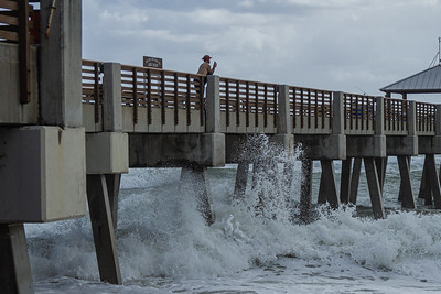 Large waves crash into the mostly empty Juno Beach Pier in Juno Beach, Tuesday, September 22, 2020. Strong easterly winds kicked up large waves up and down the coast of Palm Beach County. [JOSEPH FORZANO/palmbeachpost.com]