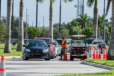 Cars line up at the COVID-19 testing site at the FITTEAM Ballpark of the Palm Beach, Wednesday, September 23, 2020. [JOSEPH FORZANO/palmbeachpost.com]