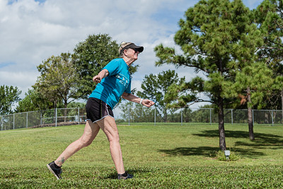 Lee Massey of Greenacres watches her shot from the fourth hole tee on the disc golf course at Okeeheelee Park, in West Palm Beach, Wednesday, September 23, 2020, Massey has been disc golfing for six years. [JOSEPH FORZANO/palmbeachpost.com]