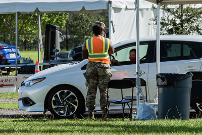 A woman gets checked in at the COVID-19 testing site at the FITTEAM Ballpark of the Palm Beach, Wednesday, September 23, 2020. [JOSEPH FORZANO/palmbeachpost.com]