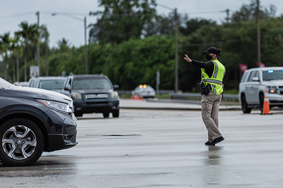 A Palm Beach County Sheriff's deputy directs traffic at the intersection of Lake Worth Road and US 441 after a gas line explosion at Lake Worth Road closed sections of Lake Worth Road and the turnpike, Thursday, September 24, 2020. [JOSEPH FORZANO/palmbeachpost.com]