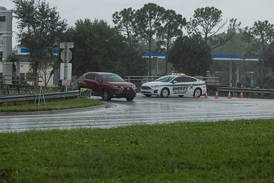 A Palm Beach County Sheriff's vehicle allows a passenger car to leave the Woods Walk Plaza after a gas line explosion at Lake Worth Road closed sections of Lake Worth Road and the turnpike, Thursday, September 24, 2020. [JOSEPH FORZANO/palmbeachpost.com]