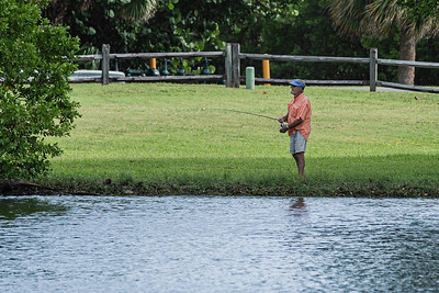 A man fishes in the lake at Carlin Park in Jupiter, Thursday, September 24, 2020. [JOSEPH FORZANO/palmbeachpost.com]