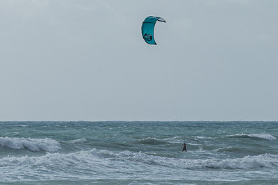 A kite surfer glides over the rough seas caused by strong easterly winds off of Juno Beach, Thursday, September 24, 2020. [JOSEPH FORZANO/palmbeachpost.com]