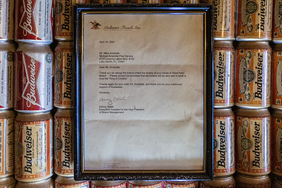 A 2001 letter from the Budweiser Corporation hangs on the wall of a condo at Lucerne Green Condominiums in Lake Worth that is covered in empty Budweiser beer cans, Tuesday, September 29, 2020. The previous owner, Mike Amolette, who passed away in June 2020, spent about 16 years covering the walls and ceilings in Budweiser cans. The exact number of cans is unknown. [JOSEPH FORZANO/palmbeachpost.com]