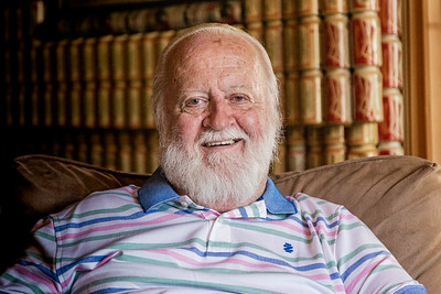 Kris Johnson, longtime friend of Mike Amolette and executor of his will, sits in the living room of the Budweiser condo at Lucerne Green Condominiums in Lake Worth that is covered in empty Budweiser beer cans, Tuesday, September 29, 2020. The previous owner, Mike Amolette, who passed away in June 2020, spent about 16 years covering the walls and ceilings in Budweiser cans. The exact number of cans is unknown. [JOSEPH FORZANO/palmbeachpost.com]