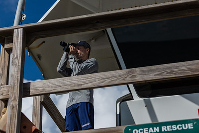 Larry Russell, an Ocean Rescue EMT and Lifeguard at Carlin Park in Jupiter, scans the waters off the beach with binoculars, Monday, September 28, 2020. [JOSEPH FORZANO/palmbeachpost.com]