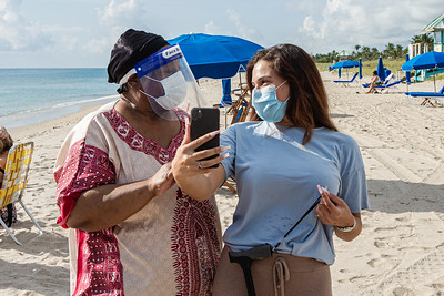 Jasmine McCrary of Miami shares a laugh with her grandmother Cynthia Kemp of Boynton Beach before taking a selfie on the sands of Delray Beach, Wednesday, September 30, 2020. McCrary took her grandmother to Delray Beach as an early celebration of Kemp's 70th birthday which is on Saturday. [JOSEPH FORZANO/palmbeachpost.com]