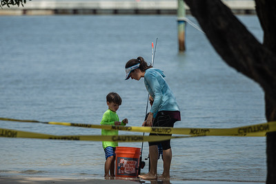 A Lantana woman fishes with her two small sons at the Boynton Beach Inlet, Wednesday, September 30, 2020. [JOSEPH FORZANO/palmbeachpost.com]