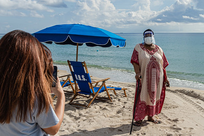 Jasmine McCrary of Miami shoots a iPhone photo of her grandmother Cynthia Kemp of Boynton Beach on the sands of Delray Beach, Wednesday, September 30, 2020. McCrary took her grandmother to Delray Beach as an early celebration of Kemp's 70th birthday which is on Saturday. [JOSEPH FORZANO/palmbeachpost.com]